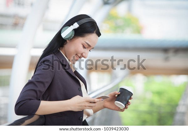 Young Beautiful Working Woman Holding Smart tablet. Business Technology concept.