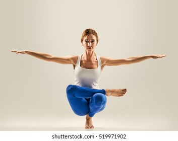 young beautiful yoga pose. balancing on one leg