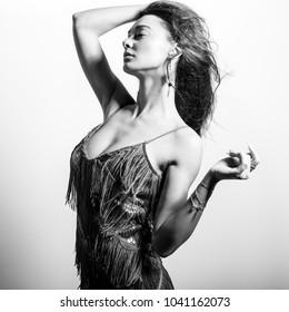 Young beautifull woman pose in studio. Black-white photo.