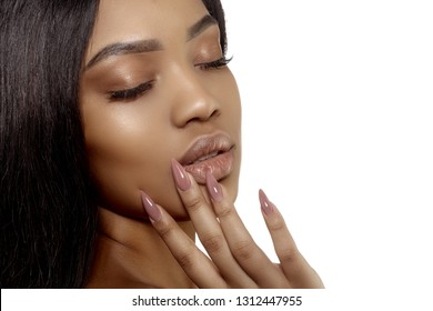 Young beauty african american woman with a perfect manicure on stylish nails isolated on white background