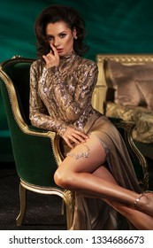 Young beauty brunette woman in a stylish room