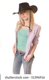 The young beauty cowgirl on isolated white background