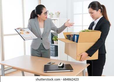 young beauty girl office worker losing company job when her boss showing working report feeling unsatisfied and fired her.