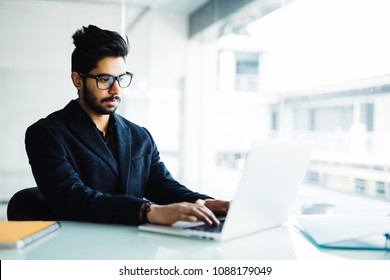 Young beauty indian male working at office