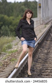 Young beauty Lady walking near railway and forest