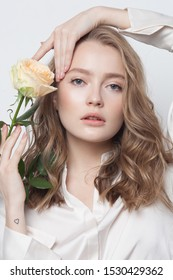 Young beauty lady with white rose, skincare concept