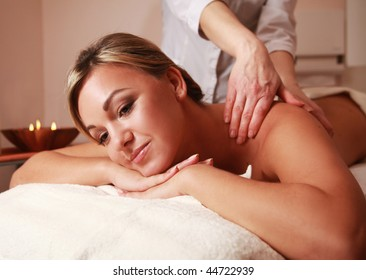 young beauty at massage procedure