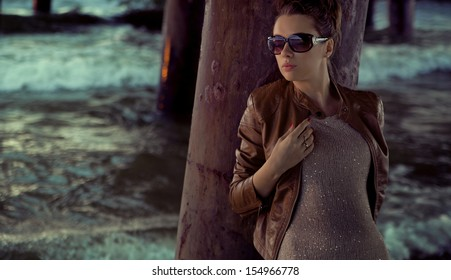 Young beauty posing in sunglasses