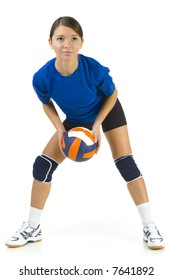 Young, beauty volleyball player. Holding ball and looking at something. Isolated on white in studio. Whole body, front view