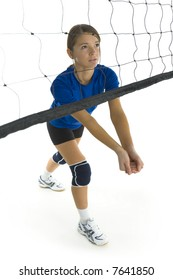Young, beauty volleyball player. Standing in front of net and preparing to take the ball. White background. Whole body, side view