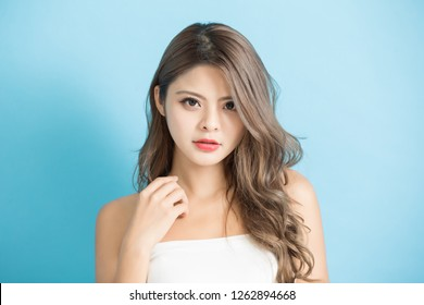 Young beauty woman with beautiful lips and hairstyle