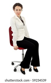 young beauty woman in business dress sitting on red armchair, isolated on white