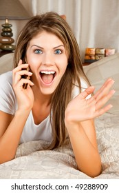 Young beauty woman couch in the bed and telephoning