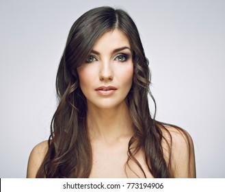 Young beauty woman face close up portrait. Female model with long hair. Isolated.
