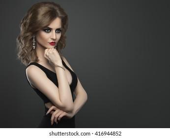 Young beauty woman fashion studio shot on dark background