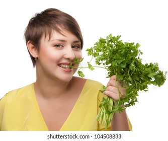 Young beauty woman with green parsley isolated on white