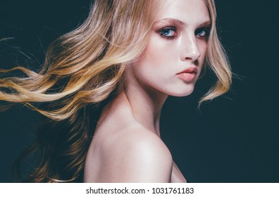 Young beauty woman with long hair blonde , beauty female portrait, girl with healthy skin and hair over black background