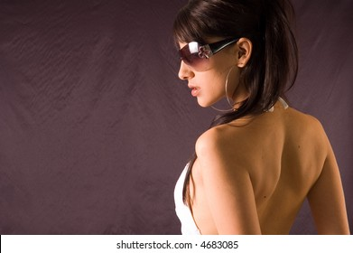 Young beauty woman looks over her shoulder