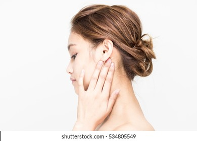 young beauty woman massaging her neck