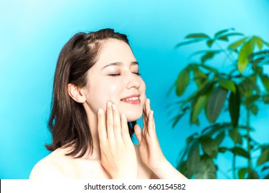 young beauty woman massaging her face. facial massage concept.