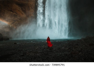 Young beauty woman over nature waterfall background in Iceland. 
