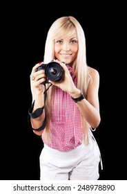 young beauty woman with photo camera isolated on black background