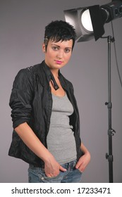Young beauty woman in photostudio