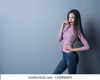 Young beauty woman posing in studio shot on gray background