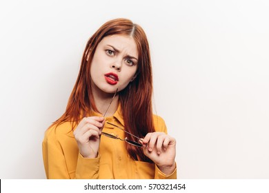Young beauty woman with a puzzled looking at the camera, light background