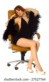 Young Beauty Woman Sitting in Leather Armchair