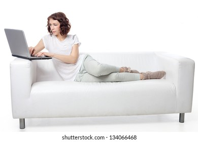 Young beauty woman sitting on the sofa with notebook