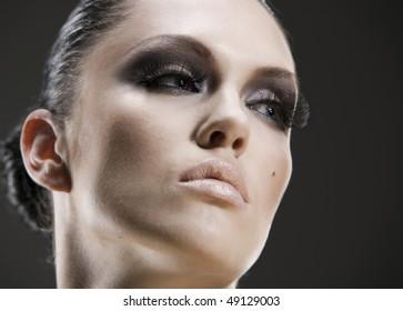 Young beauty woman stylish portrait. Skin texture saved
