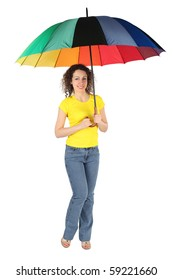 young beauty woman with toothy smile in yellow shirt with multicolored umbrella standing isolated on white