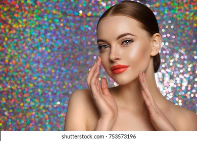 Young Beauty Woman touch own face. Fresh clean fresh glowing Skin. Beautiful girl with perfect makeup, bright manicure. Cosmetology and Facial Treatment, spa on holographic background.