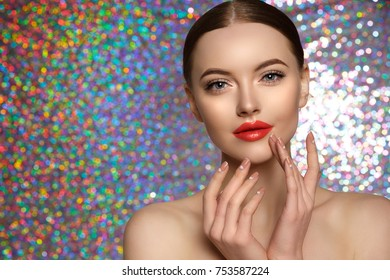 Young Beauty Woman touch own face on holographic background.. Fresh clean fresh glowing Skin. Beautiful girl with perfect makeup, bright manicure. Cosmetology and Facial Treatment, spa.