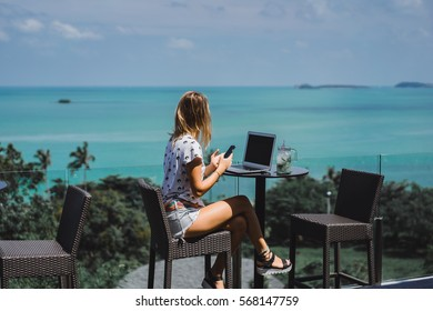 Young beauty woman using laptop on cafe