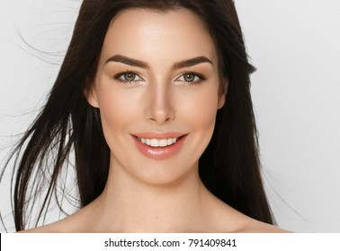 Young beauty womanl with healthy care beautiful healthy clean skin and hairstyle brunette