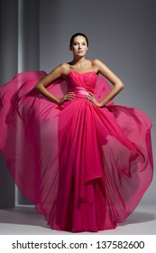 Young beautyful adult girl wearing elegant evening dress