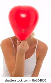 young beautyful caucasian woman with balloon