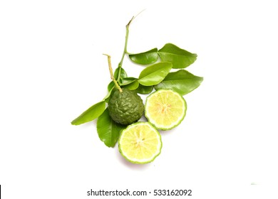young bergamots  and sliced bergamot on green with stalk on white background isolated
