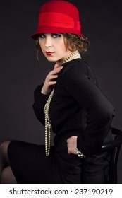Young beuriful woman in style of 1920 like Coco Chanel