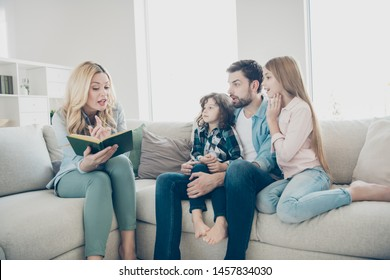 Young big family two children comfortable sitting sofa listening mommy reading exciting fairy tale