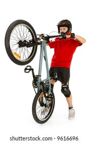 Young biker picking up front wheel his BMX. He' s in helmet and kneepad. Isolated on white background.