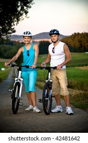young biking couple on countryside road