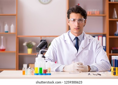 Young biochemist working in the lab
