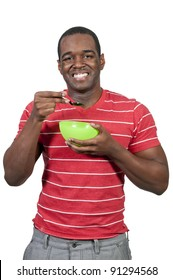 Young black African American man eating food from a bowl
