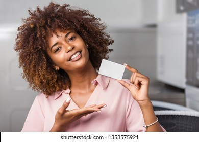 Young black African American woman holding a laundry subscription card
