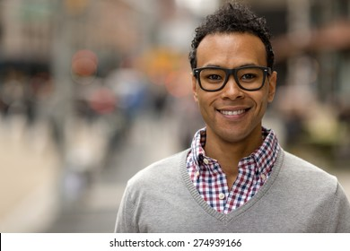 Young black African Asian man in city smile happy face portrait
