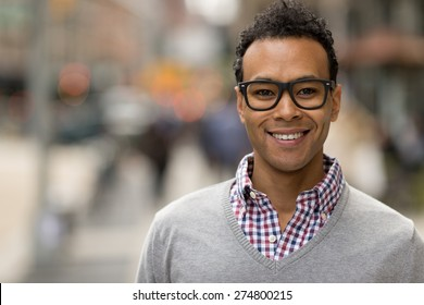 Young Black African Asian mixed man in city smile happy face portrait