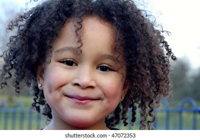 Young black baby girl with curly hair 2